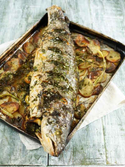 Roasted salmon stuffed with lemon & herbs