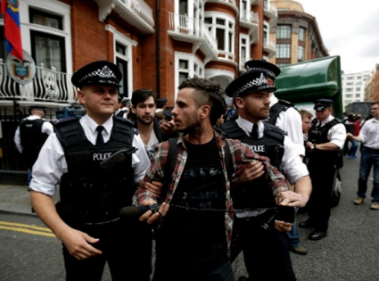 Assange sees end to standoff within year